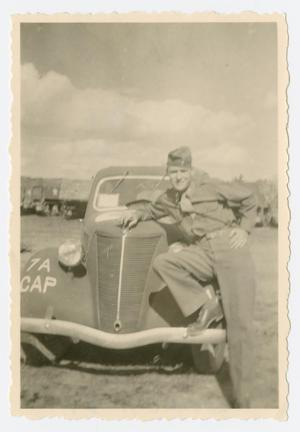 Primary view of object titled '[Lieutenant Nelson with Staff Car]'.
