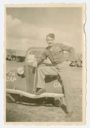 Primary view of object titled '[Lieutenant Johnson Leaning on Car]'.