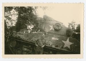 Primary view of object titled '[Man in Front of Tank]'.