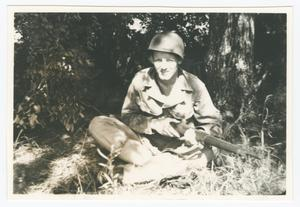 Primary view of object titled '[Soldier Sitting with a Rifle]'.