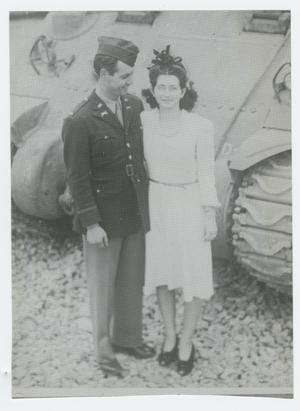 Primary view of object titled '[Charles and Anna Woodward Standing by a Tank]'.