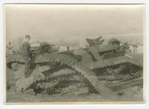 Primary view of object titled '[Soldier Standing on the Wreck of a Sherman Tank]'.