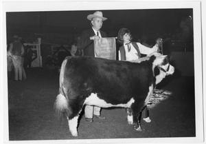 Primary view of object titled 'Reserve Champion Herford Heifer and Linda Daugherty'.