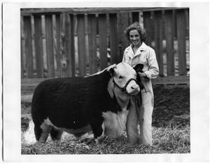 Primary view of object titled 'Ellabell Swigart with 4H Steer'.