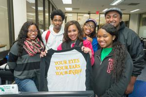 Primary view of object titled '[Students pose with NABJ shirt]'.