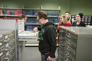 Primary view of object titled '[Doug Campbell leads library tour for journalists]'.