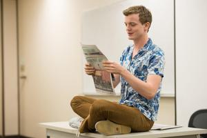 Primary view of object titled '[Student with North Texas Daily newspaper]'.