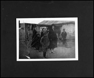 [Photograph of Lerma Family in Front of a House]