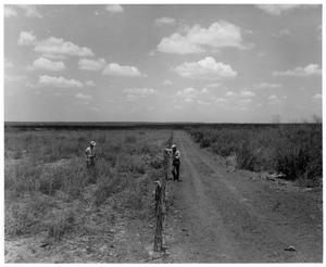 Primary view of object titled '[Photograph of Two Men near a Dirt Road]'.