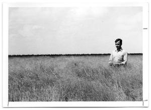 Primary view of object titled '[Photograph of a Man standing in Kleingrass]'.