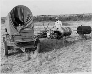Primary view of object titled 'Two Grills Next to a Wagon'.
