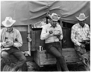 Primary view of object titled 'Men Eating Next to a Chuck-Wagon'.