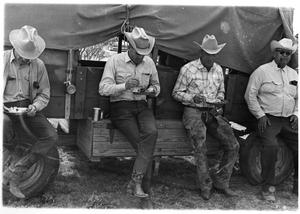 Primary view of object titled 'Cowboys Eating Next to a Chuck-Wagon'.
