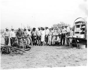 Primary view of object titled 'Large Group Next to a Chuck-Wagon'.
