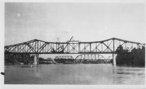 Primary view of object titled '[The construction of the Brazos River Bridge.]'.