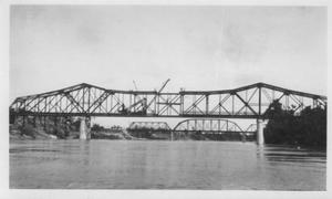 Primary view of object titled '[The final construction phase of the Brazos River Bridge.]'.