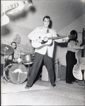 [Elvis Presley performing with the Blue Moon Boys]