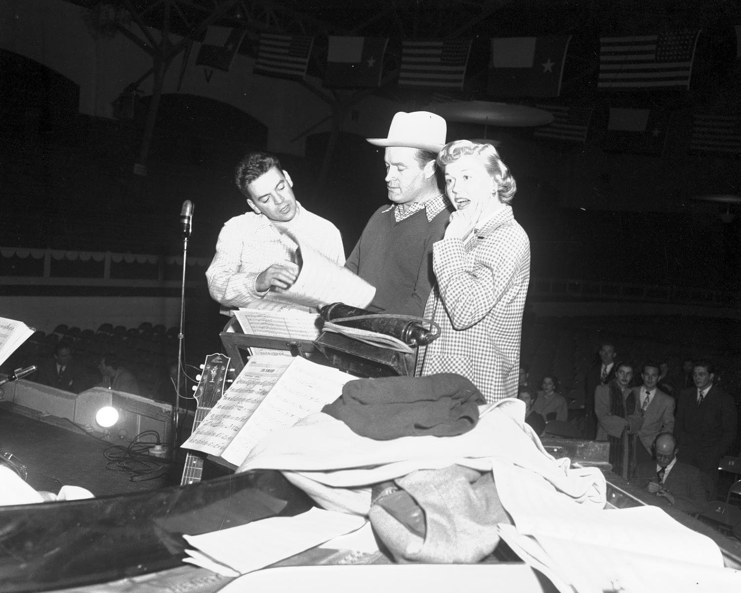 [Bob Hope, Doris Day, and Les Brown prepare for a show in Cowtown Coliseum]                                                                                                      [Sequence #]: 1 of 1