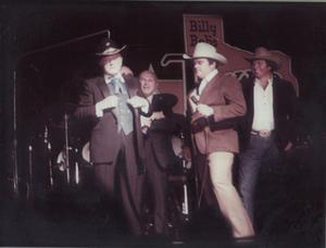 Primary view of object titled '[Bob Hope and Hub Baker at Billy Bob's Texas]'.