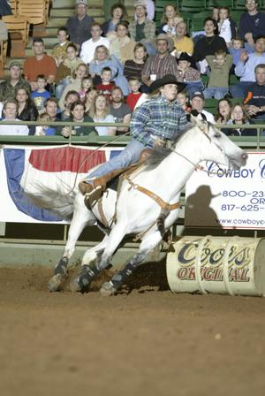 Primary view of object titled '[Cowgirl Barrel Racing at Cowtown Coliseum]'.
