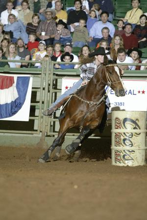 [Woman and Horse Barrel Racing at Cowtown Coliseum]