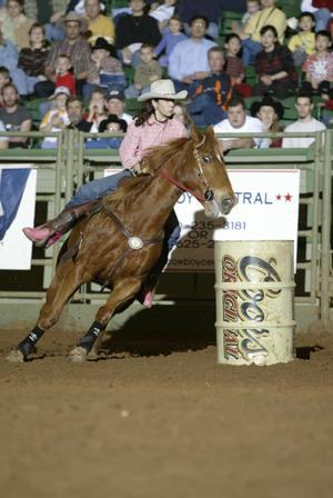 [Woman Barrel Racing at Cowtown Coliseum]