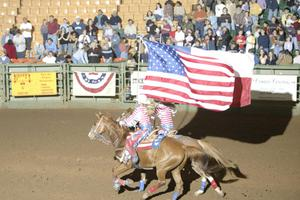 [Event at the Cowtown Coliseum, women flag bearers]
