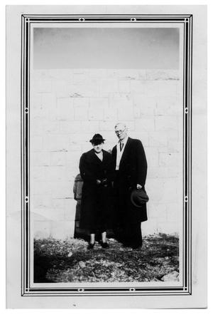 Primary view of object titled '[Photograph of Couple Next to Wall]'.