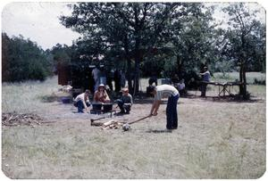 Primary view of object titled 'Camper Chopping Wood'.
