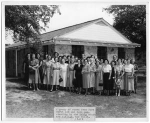 Primary view of object titled '[Group of women and one man in front of a W.S.C.S built cabin]'.