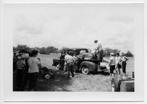 Primary view of object titled '[Group of people loading a pickup truck]'.
