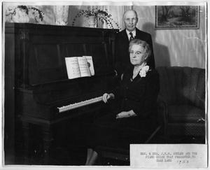 Primary view of object titled '[Rev. & Mrs. J.W.W. Shuler and a piano]'.