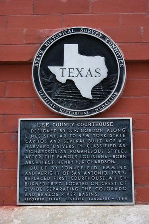 Primary view of object titled '[Plaque Mounted on Courthouse Wall]'.