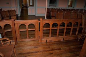 Primary view of object titled '[Wooden Railing in Courtroom]'.