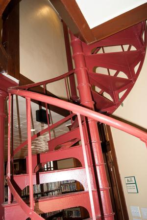 Primary view of object titled '[Photograph of a Red Spiral Staircase]'.