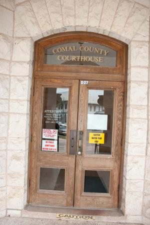 Primary view of object titled '[Doors to Comal County Courthouse]'.
