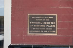Primary view of object titled '[Plaque on Red Brick Building]'.