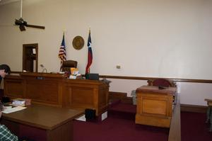 Primary view of object titled '[Desks in Courtroom]'.