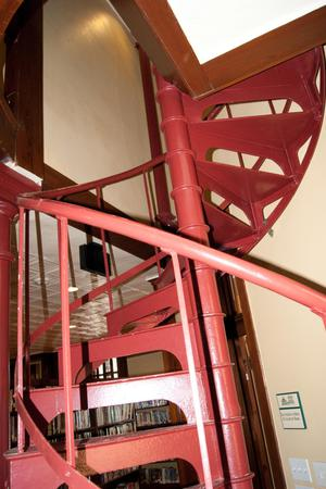 Primary view of object titled '[Red Spiral Staircase in Library]'.