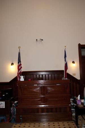 [Judge's Bench at Front of Courtroom]