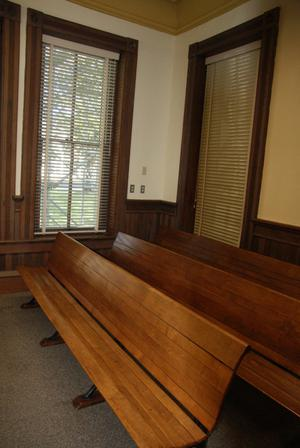 Primary view of object titled '[Wooden Benches in Courtroom]'.