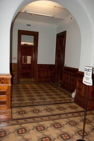Primary view of object titled '[Sign Outside Courtroom]'.