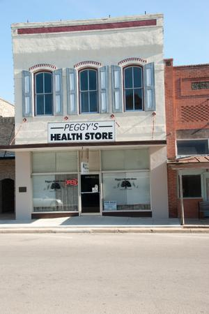 Primary view of object titled '[Exterior of Peggy's Health Store]'.