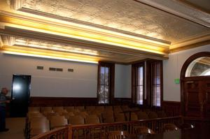 Primary view of object titled '[Four Rows of Chairs in Courtroom]'.