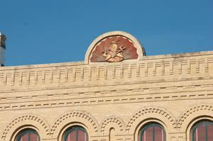 Primary view of object titled '[Emblem on Top of Building]'.