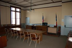 Primary view of object titled '[Furniture in a Courtroom]'.