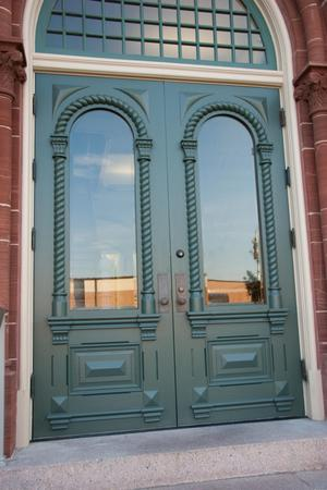 Primary view of object titled '[Photograph of Courthouse Doors]'.