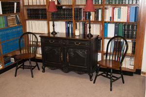 Primary view of object titled '[Chairs and Desk by Bookshelf]'.