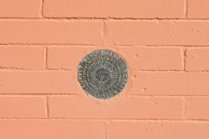 Primary view of object titled '[Medallion on Exterior of Building]'.