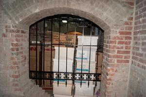 Cardboard Boxes Behind Bars